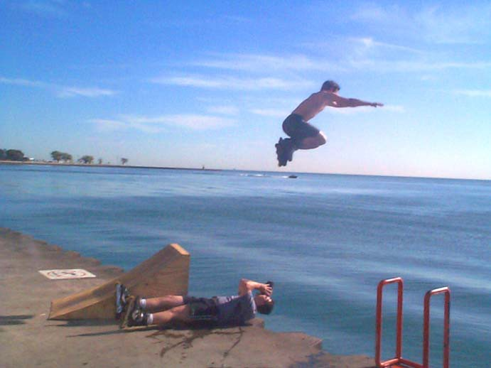 Blading: Ramp jumping into the lake at Oak Street Beach. Photo by Bill.