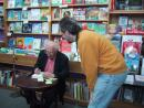 Women&Children First: Studs Terkel signing his book for Andrew. (click to zoom)