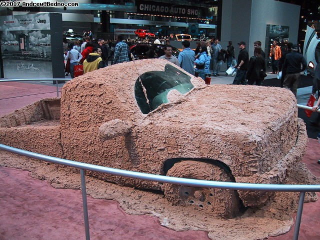 Chicago Auto Show: Truck buried in mud.