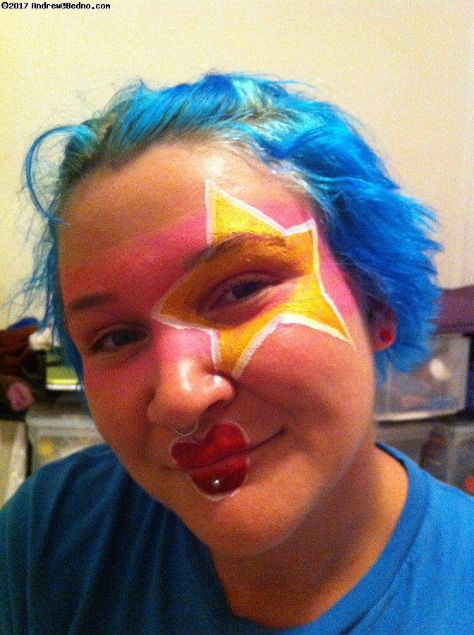 Playing with clown face painting ideas.