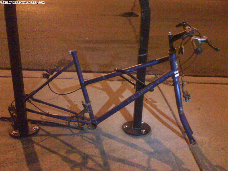 Lonely locked bike carcass.